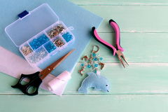Cute little dolphin, keychain handmade. Felt dolphin crafts for kids. Royalty Free Stock Images