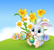 Cute little Easter Bunny painting an egg Royalty Free Stock Photo