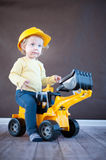 Cute Little Engineer. Cute little Girl Playing with Toy Truck Royalty Free Stock Images