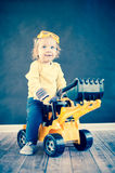 Cute Little Engineer. Cute little Girl Playing with Toy Truck Stock Photography
