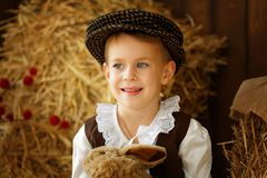 Cute little european boy in the cap with blue eyes. And bunny Royalty Free Stock Images