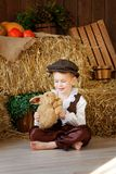 Cute little european boy in the cap with blue eyes. And bunny Royalty Free Stock Photos