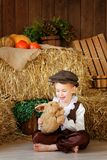 Cute little european boy in the cap with blue eyes. And bunny Royalty Free Stock Photo