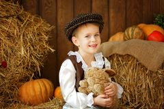 Cute little european boy in the cap with blue eyes. And bunny Stock Image
