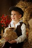 Cute little european boy in the cap with blue eyes. And bunny Stock Photo