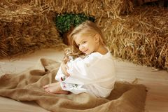 Cute little european girl. On the wooden background Royalty Free Stock Photos
