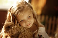 Cute little european girl. On the wooden background Stock Photos