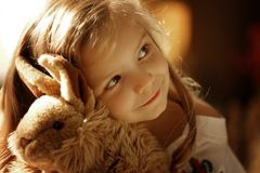Cute little european girl. On the wooden background Stock Image