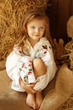 Cute little european girl. On the wooden background Royalty Free Stock Image