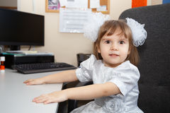Cute little excited girl with white bows Royalty Free Stock Image