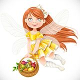 Cute little fairy girl in yellow dress with  basket of fruits Royalty Free Stock Image
