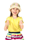 Cute little fashion girl in colorful summer clothes and hat Stock Images