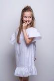 Cute little fashion model on white background. Beautiful girl studio shot. Royalty Free Stock Photography