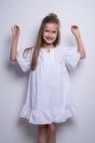 Cute little fashion model on white background. Beautiful girl studio shot. Royalty Free Stock Image