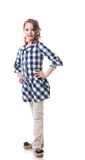 Cute little fashionista posing in checkered tunic Royalty Free Stock Photos