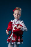Cute little figure skater posing with bronze medal Royalty Free Stock Photos