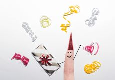 Finger with present streamers white background stock images