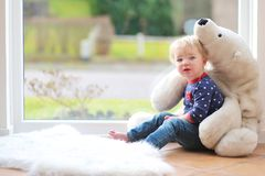 Cute little fir playing with teddy bear Stock Image