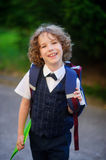Cute little first grader goes to school. Stock Photo
