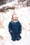 Cute little funny child in blue winter thermal upper clothes Stock Photo