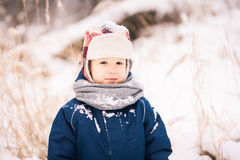 Cute little funny child in blue winter thermal upper clothes Stock Image