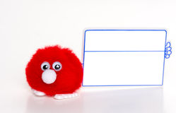 Cute, little furry ball with blank side advertising board Royalty Free Stock Photos