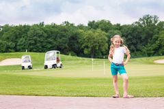 Cute little gilr on the golf course Stock Photos