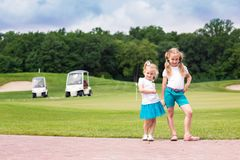 Cute little gilrs on the golf course Stock Photo