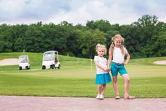 Cute little gilrs on the golf course Stock Photos