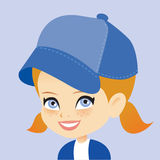 Young Girl Wearing a Beannie Hat and Smiling Royalty Free Stock Image