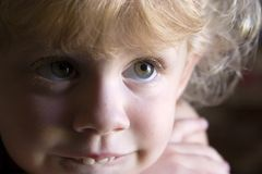 Cute little girl. A cute little curly haired blond girl stock photos