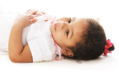 Cute little girl. Laying on white Stock Photos