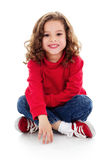 Cute little girl. Stock image of cute little girl sitting and smiling, isolated on white with shadow on floor Stock Images