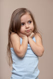 Cute little girl. Beautiful little girl holds her hands up against her neck Royalty Free Stock Photography