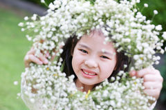 Cute little girl. Showing a flower tiara Stock Photo