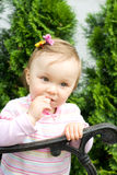 Cute little girl. Pretty baby girl plays outdoor Stock Images