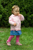 Cute little girl. Pretty pink baby girl outdoor Stock Photo