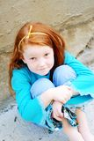 Cute Little Girl. A cute little red-haired girl, in a blue shirt and denim Royalty Free Stock Photo