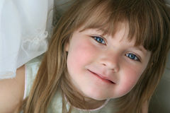Cute little girl. A cute girl lying down Stock Photos