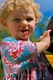 Cute little Girl. A cute little girl with blond hair looks toward camera Royalty Free Stock Photos