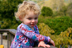 Cute Little Girl. A Cute little girl with her arms crossed looking out fondly Royalty Free Stock Photo
