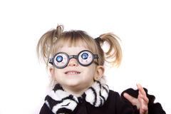 Cute Little Girl Acting Silly. A little blond girl wearing silly eye glasses Royalty Free Stock Photo