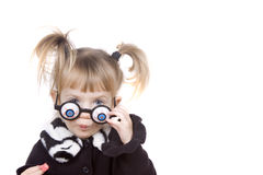 Cute Little Girl Acting Silly. Toddler girl making silly faces with eyeball glasses Stock Image
