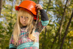 Cute Little Girl Adjusting Her Hardhat Royalty Free Stock Photos