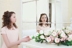 Cute little girl admiring her reflection in mirror Royalty Free Stock Image