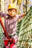 Cute little girl in Adventure Park. Little girl is climbing in the adventure park royalty free stock photos