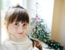 Cute little girl in anticipation of the holiday Stock Photo