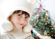 Cute little girl in anticipation of the holiday Royalty Free Stock Photos