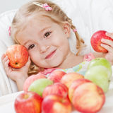 Cute little girl with apple Stock Photography