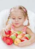 Cute little girl with apple Royalty Free Stock Photos